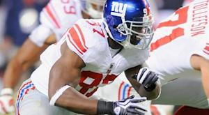 Giants cut LB Sintim, DE Trattou