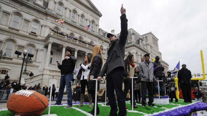 Baltimore Ravens rookie kicker Justin Tucker points to the sky at the start of  a victory parade outside of City Hall Tuesday, Feb. 5, 2013 in Baltimore. The Ravens defeated the San Francisco 49ers in NFL football's Super Bowl XLVII 34-31 on Sunday. (AP Photo/Gail Burton)
