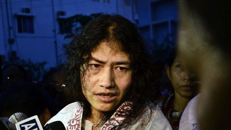 Indian human rights activist Irom Sharmila speaks to the media outside a prison hospital in Imphal