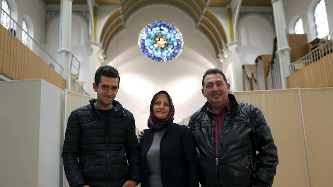 Migrant Syrian family pose inside a Protestant church in Oberhausen