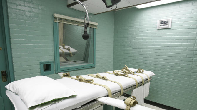 FILE - This May 27, 2008 file photo shows the State of Texas execution chamber in Huntsville, Texas. A leading association for pharmacists on Monday has approved a proposal declaring that participation in lethal injection executions by compounding pharmacies would be a violation of core pharmacy values. (AP Photo/Pat Sullivan, File)