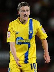 Crawley have met the release clause in Eunan O'Kane's contract and could sign him from Torquay