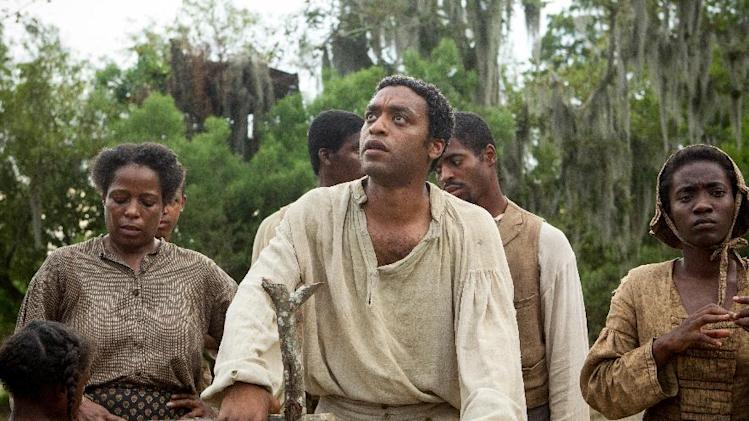 "This image released by Fox Searchlight shows Chiwetel Ejiofor, center, in a scene from ""12 Years A Slave."" The Golden Globes nominations will be announced on Thursday, Dec. 12. (AP Photo/Fox Searchlight, Jaap Buitendijk)"
