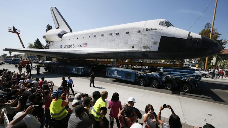 The space shuttle Endeavour is moved to the California Science Center in Los Angeles on Saturday, Oct. 13, 2012. (AP Photo/Lucy Nicholson, Pool)