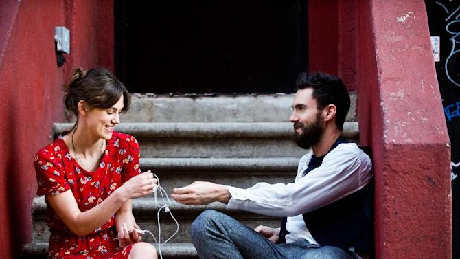 """This image released by The Weinstein Company shows Keira Knightley, left, and Adam Levine in a scene from """"Begin Again."""" Levine says his acting debut in the film """"Begin Again"""" has inspired him to continue acting. The part, playing a young musician who strikes it big, was easy to identify with for the pop star. (AP Photo/The Weinstein Company, Andrew Schwartz)"""