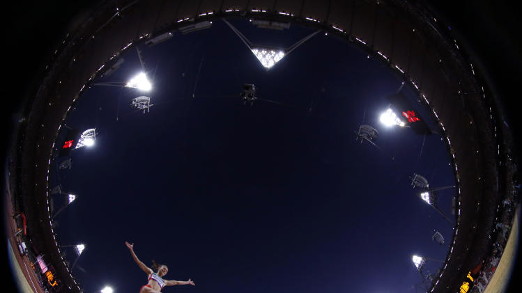 FILE - In this Wednesday, Aug. 8, 2012 file photo taken with a fisheye lens, Belarus' Nastassia Mironchyk-Ivanova competes in the women's long jump final during the athletics in the Olympic Stadium at the 2012 Summer Olympics, in London. (AP Photo/Matt Dunham, File)