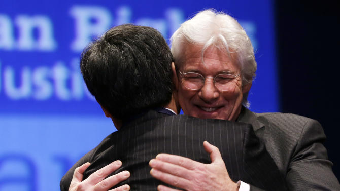 Actor Richard Gere hugs Chinese human rights activist Chen Guangcheng, after awarding Guangcheng the 2012 Tom Lantos Human Rights Prize on Capitol Hill in Washington, on Tuesday, Jan. 29, 2013. (AP Photo/Jacquelyn Martin)