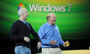 Windows President Steven Sinofsky (left) laughs with Microsoft CEO Steve Ballmer during a 2009 presentation. Sinofsky has abruptly resigned after 23 years at the company.