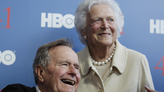 FILE - In a Tuesday, June 12, 2012 file photo, former President George H.W. Bush, and his wife former first lady Barbara Bush, arrive for the premiere of HBO's new documentary on his life near the family compound in Kennebunkport, Maine. Former President Bush has been hospitalized for about a week in Houston for treatment of a lingering cough. Bush's chief of staff, Jean Becker, says the 88-year-old former president is being treated for bronchitis at Houston's Methodist Hospital and is expected to be released by the weekend. He was admitted Friday, Nov. 23, 2012.  (AP Photo/Charles Krupa, File