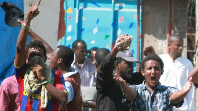 Kenya Muslim Youths shout slogans, proclaiming Allah Akbar (God is Great) as they engage with Kenyan anti riot police outside Masjid Musa in Majengo, Mombasa, Kenya, Sunday, Feb. 2, 2014. A riot outside a mosque in Kenya's coastal resort and port city of Mombasa has left at least one police officer injured. (AP Photo)