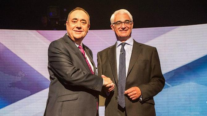A picture dated August 5, 2014 shows Scotland's First Minister Alex Salmond (L) shaking hands with leader of Better Together campaign and former minister Alistair Darling (R) ahead of STV live television debate on Scottish independence in Glasgow