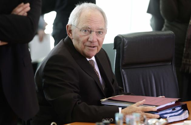 German Finance Minister Schaeuble awaits start of cabinet meeting in Berlin