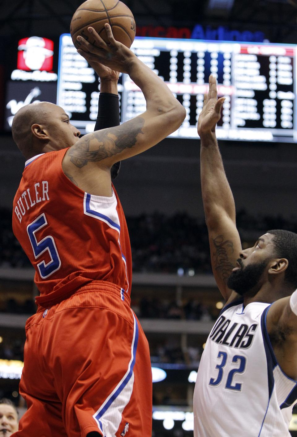 Los Angeles Clippers forward Caron Butler (5) shoots over Dallas Mavericks guard O.J. Mayo (32) during the first half of an NBA basketball game, Tuesday, March 26, 2013, in Dallas. (AP Photo/Brandon Wade)