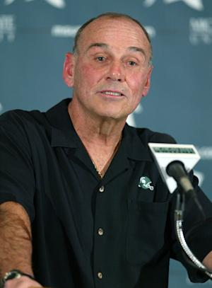 FILE - In this Nov. 1, 2006, file photo, then-Michigan State coach John L. Smith speaks to reporters at an NCAA college football news conference, in East Lansing, Mich. A person familiar with the decision says Arkansas is bringing back John L. Smith on an interim basis next year to replace Bobby Petrino. Petrino was fired April 10 after his affair with a woman he hired as his assistant was revealed by an April 1 motorcycle crash. (AP Photo/Al Goldis, File)