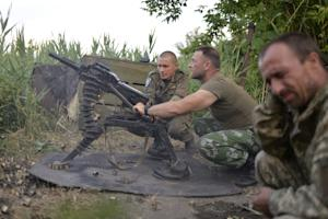Ukrainian servicemen use an automatic grenade launcher…