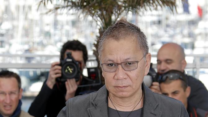 Director Takashi Miike poses for photographers during a photo call for the film Shield of Straw at the 66th international film festival, in Cannes, southern France, Monday, May 20, 2013. (AP Photo/Lionel Cironneau)