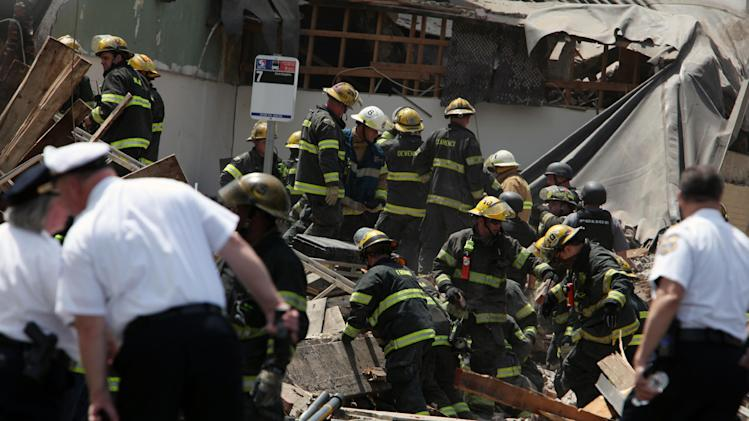FILE - In this file photo taken June 5, 2013, rescue personnel search the rubble of a building that collapsed on Market Street in downtown Philadelphia, leaving six people dead. Philadelphia District Attorney Seth Williams on Monday, Nov. 25, 2013 said that contractor Griffin T. Campbell has been charged with third-degree murder, as well as manslaughter, in connection with the collapse. (AP Photo/Jacqueline Larma, File)