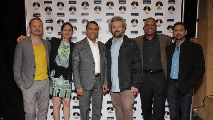 From left, Damian Mackiewicz, Paula Davis, CEO of Harman Dinesh Paliwal, director Jacob Rosenberg, Ralph Santana, and Sean Kapoor arrives at the Distortion of Sound documentary premiere presented by Harman at the Grammy Museum on Thursday, July 10, 2014, in Los Angeles. (Photo by Todd Williamson/Invision for Harman/AP Images)