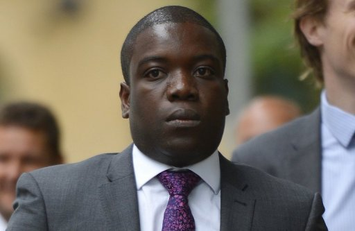 <p>Former UBS banker Kweku Adoboli arrives at Southwark Crown Court in London on September 14 during his trial on charges of alleged fraud and false accounting. Adoboli, accused of losing $2.3 billion (1.78 billion euros), broke down in tears as he took to the witness stand for the first time in his trial in London on Friday.</p>