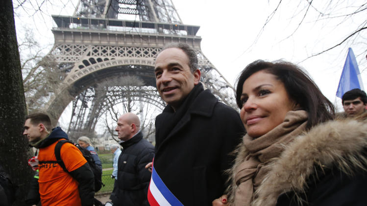 Jean-France Cope, head of conservative opposition UMP party, and his wife Nadia, take part in a demonstration against same-sex marriage in Paris, Sunday, Jan.13, 2013. Many thousands of protesters are mobilizing against the French president's plan to legalize gay marriage, streaming into Paris by bus, car and specially reserved high-speed train. (AP Photo/Michel Euler)