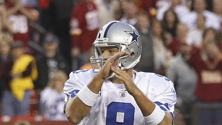 Dallas Cowboys quarterback Tony Romo signals for a time out during overtime in an NFL football game against the Washington Redskins in Landover, Md., on Sunday, Nov. 20, 2011. Romo was the holder, and tried to call timeout as the play clock was running down before the Cowboys attempted a 39-yard field goal. The Cowboys won 27-24. (AP Photo/Pablo Martinez Monsivais)