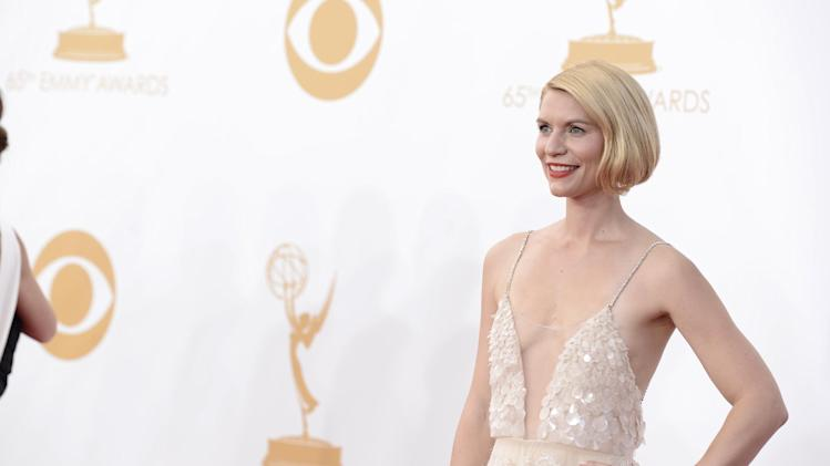 Claire Danes, wearing Atelier Versace, arrives at the 65th Primetime Emmy Awards at Nokia Theatre on Sunday Sept. 22, 2013, in Los Angeles. (Photo by Dan Steinberg/Invision/AP)