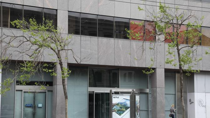 "In this photo taken Thursday, May 3, 2012, a woman walks past a vacant office building on Market Street near Twitter's new headquarters in San Francisco. With Twitter's new headquarters set to open there soon, residents of a San Francisco neighborhood notorious for crime, drugs and homelessness remain among the least likely to have any way to send a tweet, much less access to basic goods and services. At a recent weekend ""hackathon,"" engineers and entrepreneurs sought ways to use tech to help people in the Tenderloin and Mid-Market Street area find food, housing, healthcare and jobs. In the process, city leaders hope to ease tensions between needy locals and newly arriving startups flush with cash. (AP Photo/Eric Risberg)"