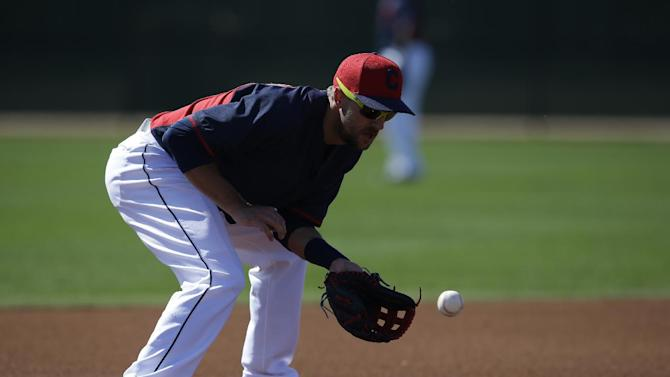 Cleveland Indians' Lonnie Chisenhall (8) in action during spring training baseball practice Thursday, Feb. 26, 2015, in Goodyear, Ariz. (AP Photo/Darron Cummings)