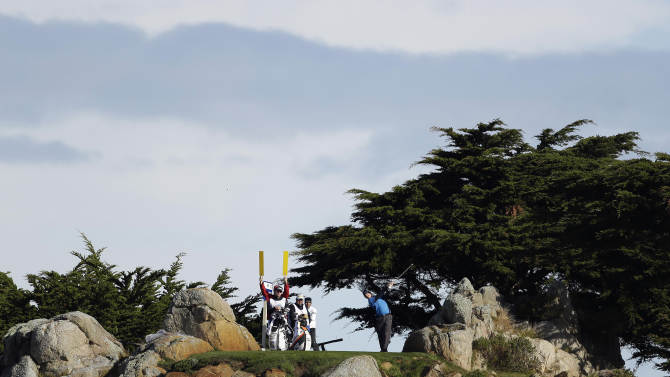 Hunter Mahan hits from the 11th tee of the Monterey Peninsula Country Club Shore Course during the second round of the AT&T Pebble Beach Pro-Am golf tournament on Friday, Feb. 8, 2013, in Pebble Beach, Calif. (AP Photo/Eric Risberg)