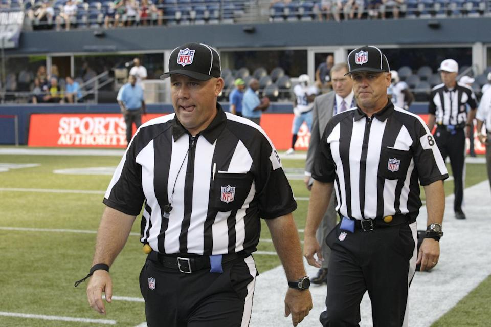 Replacement officials take the field at the start of an NFL football preseason game between the Seattle Seahawks and the Tennessee Titans, Saturday, Aug. 11, 2012, in Seattle. (AP Photo/Rick Bowmer)