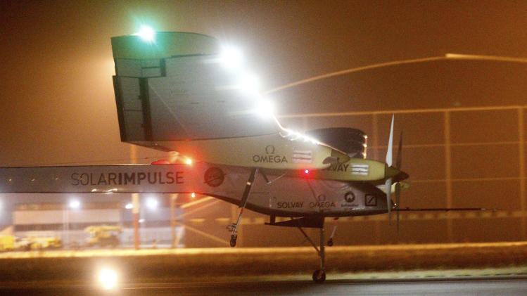An experimental solar-powered plane, Solar Impulse, approaches to make a night landing at Rabat airport, Morocco, Tuesday, June 5, 2012 after a 20-hour trip from Madrid in the first transcontinental flight by a craft of its type. (AP Photo/Abdeljalil Bounhar)