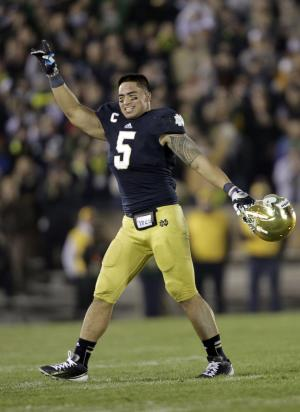 Notre Dame linebacker Manti Te'o acknowledges the applause of fans as he leaves his final home game late in the fourth of an NCAA college football against Wake Forest game in South Bend, Ind., Saturday, Nov. 17, 2012. Notre Dame defeated Wake Forest 38-0. (AP Photo/Michael Conroy)