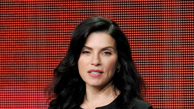 "Julianna Margulies participates in ""The Good Wife"" panel at the CBS Summer TCA on Monday, July 29, 2013, at the Beverly Hilton hotel in Beverly Hills, Calif. (Photo by Chris Pizzello/Invision/AP)"