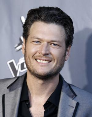"FILE - In this June 29, 2011 file photo, country singer and judge on the singing competition series ""The Voice,"" Blake Shelton poses for photographers after finale of ""The Voice"" in Burbank, Calif. While talent shows like ""The Voice"" and ""American Idol""  are designed to make stars out of unknown talent, they've also had the effect of boosting the fortunes of some of the contests celebrity judges.  (AP Photo/Matt Sayles)"