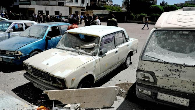 In this photo which AP obtained from the Syrian official news agency SANA, and has been authenticated based on its contents and other AP reporting, damages are seen after a series of mortar shells hit Damascus, killing more than a dozen people and wounding scores in Syria, Tuesday, April 29, 2014. The attacks in the Syrian capital came a day after President Bashar Assad announced his candidacy for the June 3 presidential election. (AP Photo/SANA)