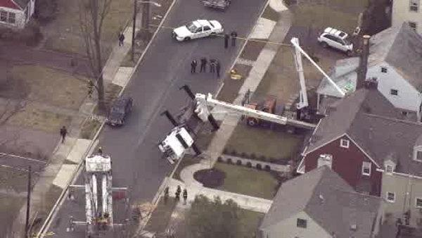Large crane topples over in NJ, injuring one worker