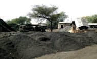 A partial view of the Chinese-owned Collum Coal mine in Sinazongwe, south of Lusaka, August 7, 2012. Chinese firms in Zambia have a notorious reputation as employers. A report by Human Rights Watch last year found that Chinese firms ignore labour protections, demanding up to 18 hours of labour a day and flout health and safety rules