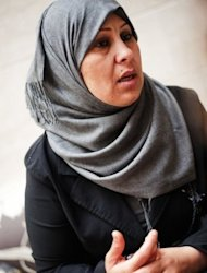 Zahia Attia, constituent assembly candidate, speaks to the press during a conference on the role of Libyan women in politics in Tripoli on May 15. Showing that women in Libya can be much more than just sexy bodyguards or accessories to murder, women are dipping into politics in the hope of drafting a constitution which protects their rights