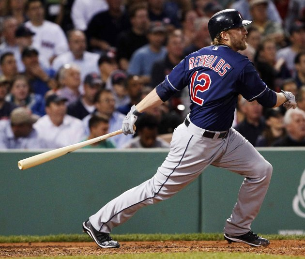 Cleveland Indians designated hitter Mark Reynolds singles to bring in two runs in the third inning of their MLB American League baseball game against  the Boston Red Sox at Fenway Park in Boston