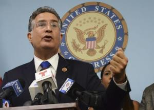 U.S. Congressman Joe Garcia speaks out against Venezuela's plan to sell its U.S. refining-and-retail unit its of state-owned oil company at his district office in West Kendall