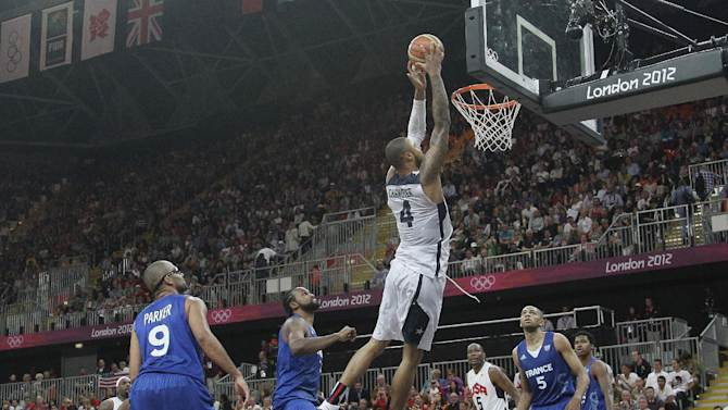 USA's Tyson Chandler (4) goes in for a dunk during the second half of a preliminary men's basketball game against France at the 2012 Summer Olympics, Sunday, July 29, 2012, in London. The U.S. men beat France 98-71.  (AP Photo/Charles Krupa)
