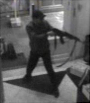 FILE - In this hand out file photo distributed on Sunday, May 25, 2014 by the Belgian Federal Police, a surveillance camera shows a man shooting at the Jewish museum in Brussels, Belgium, on Saturday, May 24, 2014. The Paris prosecutor's office said a man has been arrested Friday May 30, 2014 in the investigation of the shooting at the Jewish museum in Brussels that left at least three people dead. (AP Photo/Belgian Federal Police, File)