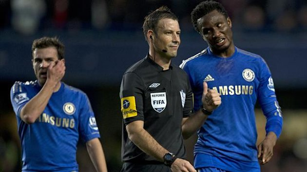 Mark Clattenburg speaks to John Obi Mikel (AFP)