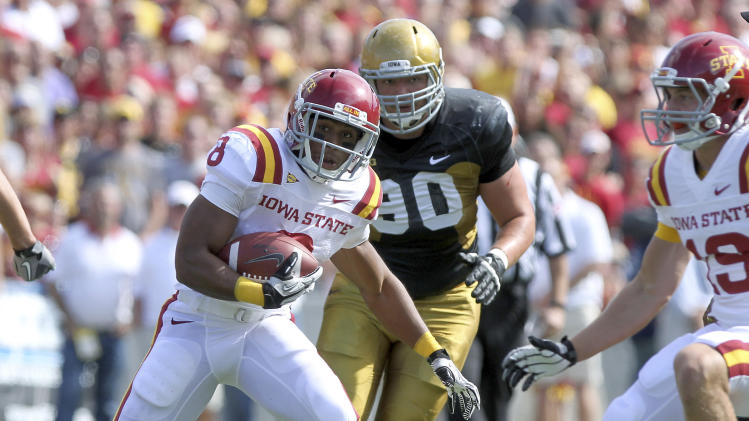 Iowa State running back James White looks for an opening during the first half agianst Iowa in an NCAA college football game Saturday, Sept. 8, 2012, in Iowa City, Iowa. (AP Photo/Conrad Schmidt)