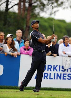 Woods at 1 under after storm-delayed day in Turkey