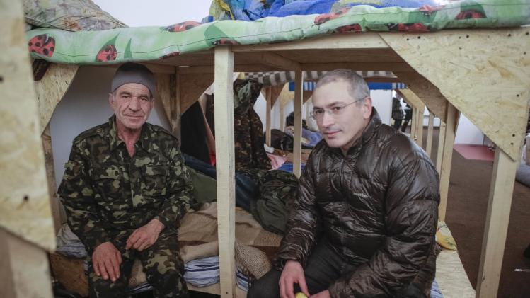 Russian former oil tycoon Mikhail Khodorkovsky speaks with a member of the Maidan self-defense battalion during his visit to Kiev