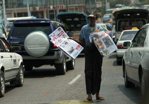 <p>A Myanmar vendor sells local newspapers on a road in Yangon. The World Bank has approved an $80 million grant for Myanmar to support its reform drive, resuming assistance for the former pariah nation after a quarter-century absence.</p>