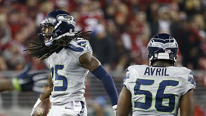 Seattle Seahawks cornerback Richard Sherman (25) celebrates next to defensive end Cliff Avril (56) after intercepting San Francisco 49ers quarterback Colin Kaepernick during the fourth quarter of an NFL football game in Santa Clara, Calif., Thursday, Nov. 27, 2014