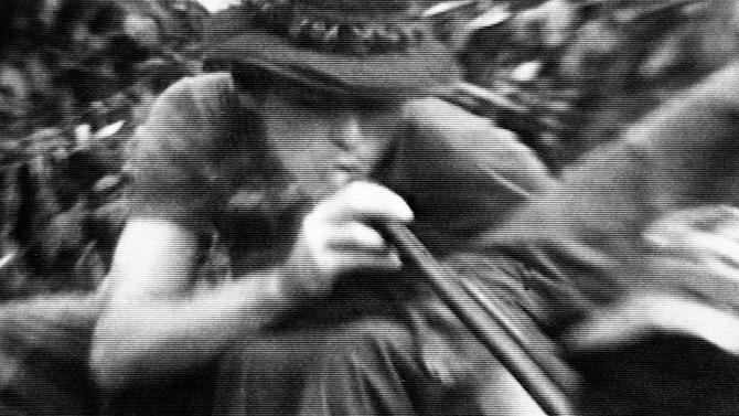 "FILE - In this file still image made from Nov. 13, 1970, video, soldiers in fire support base Aries, a small clearing in the jungles of War Zone D, 50 miles from Saigon, smoke marijuana using the barrel of a shotgun they nicknamed ""Ralph"" to get high. On the occasion of  ""Legalization Day,"" Thursday, Dec. 6, 2012, when Washington's new law takes effect, AP takes a look back at the cultural and legal status of the ""evil weed"" in American history. (AP Photo/Jim Wells, File)"