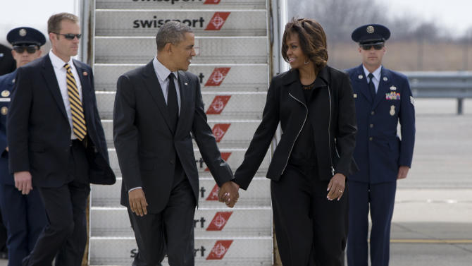 President Barack Obama and first lady Michelle Obama hold hands as they step from Air Force One, Friday, April 11, 2014, at John F. Kennedy International Airport in New York, as they travel to the Al Sharpton's National Action Network's 16th Annual Convention. (AP Photo/Carolyn Kaster)